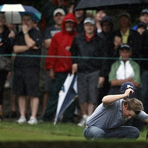 Webb Simpson reacts after missing a close putt on the ninth green during the Presidents Cup.