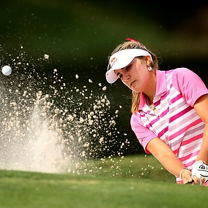 Lexi Thompson hits a bunker shot at No. 12 on Saturday at the CME Group Titleholders at Grand Cypress.
