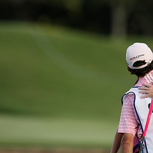 Paula Creamer hugs her caddie Colin Cann during the final round of the CME Group Titleholders at Grand Cypress in Orlando, Fla.