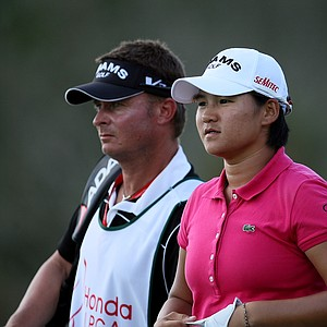 Yani Tseng with caddie Jason Hamilton during the final round of the CME Group Titleholders at Grand Cypress in Orlando, Fla.
