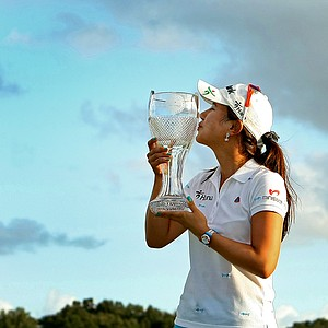 Hee Young Park kisses the trophy after winning the season ending CME Group Titleholders at Grand Cypress in Orlando, Fla.
