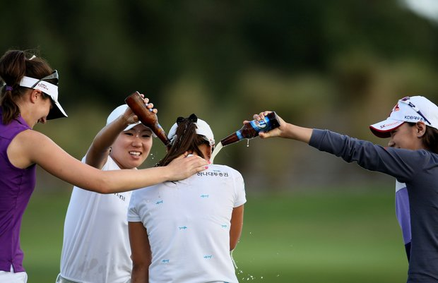 Na Yeon Choi, right, and I. K. Kim, center left, douse Hee Young Park with beer as Sandra Gal congratulates her during the final round of the CME Group Titleholders at Grand Cypress in Orlando, Fla.