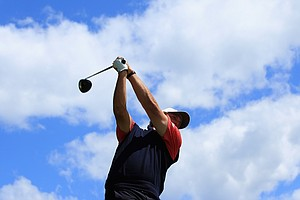 Phil Mickelson of the U.S. plays his tee shot on the 15th hole during the Day Four singles matches of the 2011 Presidents Cup.