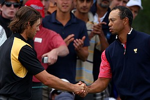 Aaron Baddeley, left, of the International team shakes hands with Tiger Woods of the U.S. after Woods won his match on the 15th hole during the Day Four singles matches of the 2011 Presidents Cup.