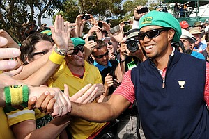 Tiger Woods of the U.S. celebrates with fans after the U.S. team defeated the International team on the final day of the Presidents Cup.