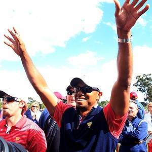 Tiger Woods of the U.S. celebrates after winning his match on the 15th hole during the Day Four singles matches of the 2011 Presidents Cup.