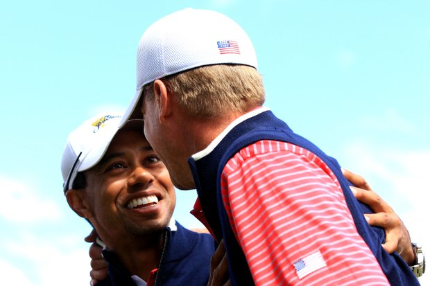 Tiger Woods of the U.S. celebrates with teammate Steve Stricker during the Day Four singles matches of the 2011 Presidents Cup.