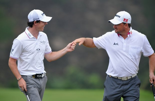 Rory McIlroy and Graeme McDowell of Ireland celebrate together during Day 3 fourballs at the Omega Mission Hills World Cup.
