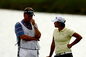 Yani Tseng and her caddie Jason Hamilton chat at No. 18 on Friday at the CME Group Titleholders at Grand Cypress.