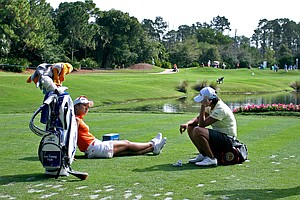 Hee Youing Park and Yani Tseng chat while waiting at No. 12 on Friday at the CME Group Titleholders at Grand Cypress.