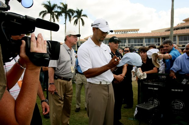 Tiger Woods signs autographs after a press conference at the World Golf Championships at Doral Resort and Spa.