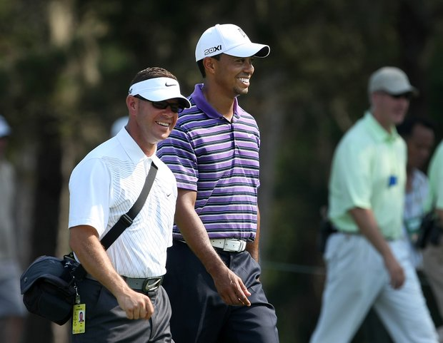 Tiger Woods and his swing coach Sean Foley walk down the fairway during a Tuesday practice round at The Players Championship at TPC Sawgrass.