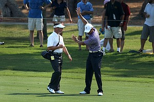 Tiger Woods goes over some technique with Sean Foley on a Tuesday practice round during The Players Championship at TPC Sawgrass.