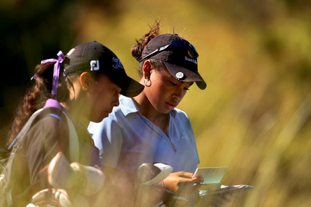 Ginger Howard (right) with younger sister Robbi during the opening round of LPGA Qualifying School at LPGA International.