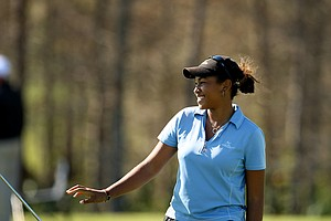 Ginger Howard smiles to her sister/caddie during the opening round. Howard won the Stage II LPGA Qualifying Tournament in Venice.