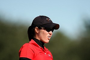 Laura Crawford watches her shot at the par 3, No. 14, during the opening round. Crawford of South Carolina posted a 76.
