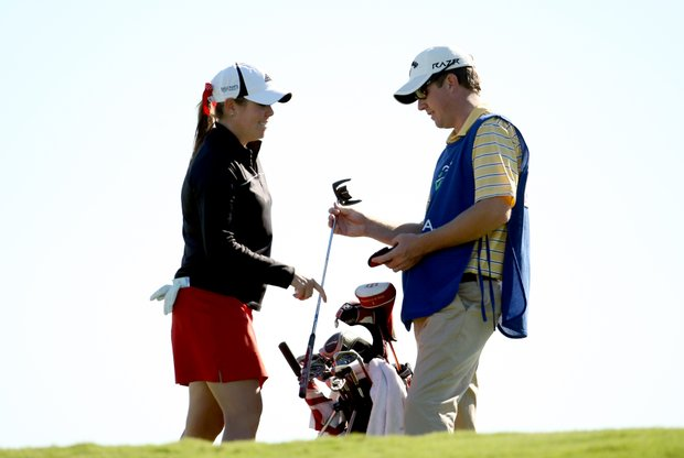 Laura Martin and her caddie/husband Alex Martin at No. 16 during the opening round. Martin posted a 78 in Round 1.
