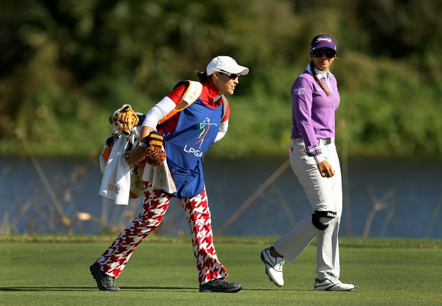 Nicole Hage and her caddie Christi Dorece during the opening round of LPGA Qualifying School at LPGA International.