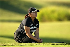 Lizette Salas gets low to read her putt while waiting her turn at No. 9 during the opening round. Salas posted a 72 on Wednesday.