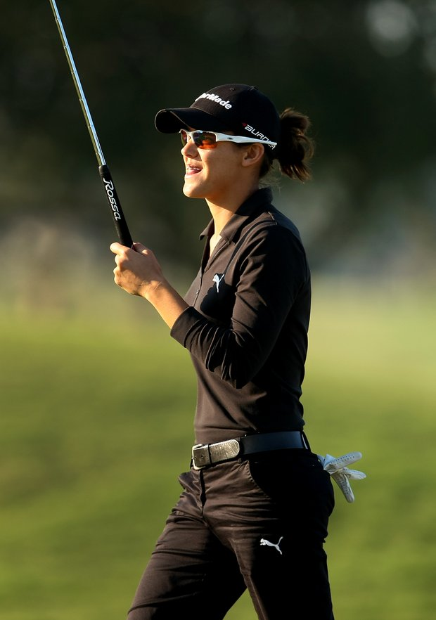 Dawn Shockley reacts to birdie at No. 9. She posted a 73.