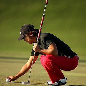 Susan Nam of Canada lines up her putt at No. 9 during the opening round. Nam shot a 77.