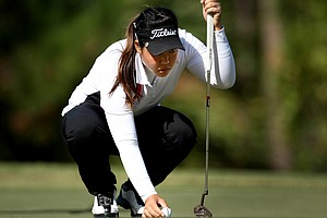 Christine Song lines up a putt on the Legends Course during the second round. Song posted a second round 70 and still holds the lead.
