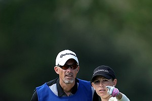 Sara Brown of Big Break fame on the Golf Channel chats with her caddie on the Legends Course during the second round.