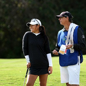 Two-time U. S. Women's Amateur Champion, Danielle Kang, chats with her caddie, Terry McNamara, during the second round of LPGA Qualifying Tournament at LPGA International. McNamara was Annika Sorenstam's longtime caddie.