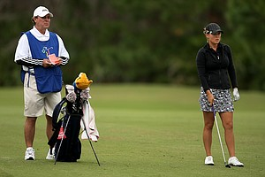 Mallory Blackwelder prepares to hit a shot while her father/caddie Worth Blackwelder watche. Worth Blackwelder is a LPGA caddy and caddied for several players including Juli Inkster and Cristie Kerr.
