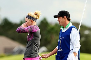 Nicole Smith of Big Break Ireland on the Golf Channel consults with her caddie, Mark Murphy, the winner of Big Break Ireland, during the second round.