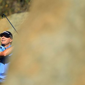 Steve Stricker watches his tee shot on the eighth hole during the first round of the Chevron World Challenge.