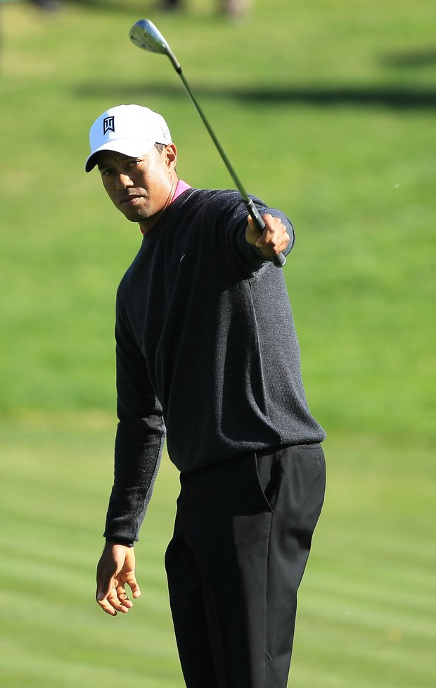 Tiger Woods watches a shot on the seventh hole during the first round of the Chevron World Challenge.