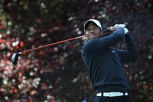 Tiger Woods hits his tee shot on the second hole during the first round of the Chevron World Challenge.