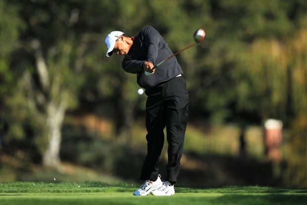 Tiger Woods hits his tee shot on the fifth hole during the first round of the Chevron World Challenge.