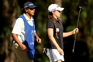 Victoria Tanco with her caddie on the Legends course. Tanco is tied for 41st heading into Saturday.