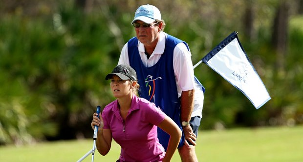 Mallory Blackwelder, who appeared on the most recent season of Big Break, reads a putt with her father/caddie Worth Blackwelder during the third round of LPGA Q-School.