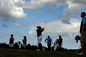 Stephanie Kono is silhouetted as she hits a shot on the Champions course during the third round.
