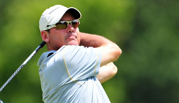Rich Beem hits a shot during the first round of the 93rd PGA Championship at the Atlanta Athletic Club.