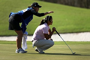 Junthima Gulyanamitta of Thailand with her sister/caddie Russy Gulyanamitta during the fourth round. Gulyanamitta posted a 68 to move from 5th to 2nd.