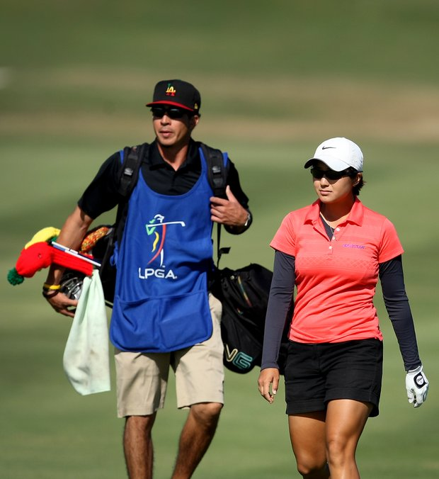 Kimberly Kim and her caddie make their way up No. 15 during the fourth round. Kim did not make the cut after posting +37 for four rounds.