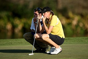 Maude-Aimee Leblanc formerly of Purdue with her caddie at No. 18. Leblanc made the cut and is T5.