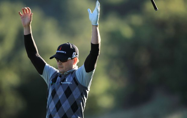 Zach Johnson reacts after holing out for eagle on the 18th hole during the third round of the Chevron World Challenge.