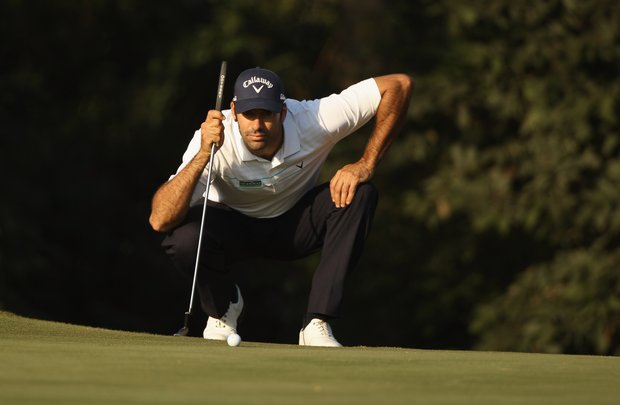 Alvaro Quiros of Spain lines up a put during Round 3 of the UBS Hong Kong Open.