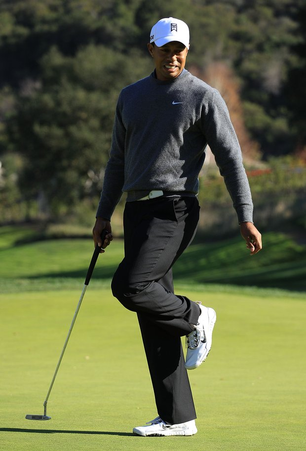 Tiger Woods reacts to a missed eagle putt on the 11th hole during the third round of the Chevron World Challenge.