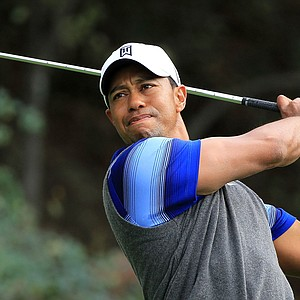 Tiger Woods watches a tee shot on the 18th hole during the second round of the Chevron World Challenge.