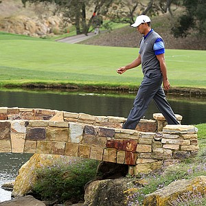 Tiger Woods crosses a bridge on the 18th hole during the second round of the Chevron World Challenge.