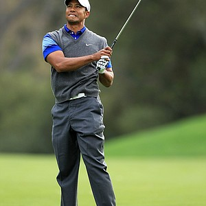 Tiger Woods watches his approach shot on the 18th hole during the second round of the Chevron World Challenge.