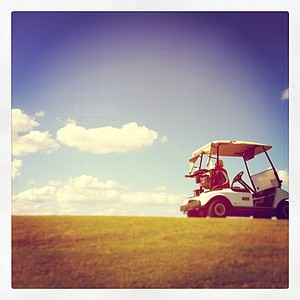 Instagram photo of a score keeper watching from a hill during fourth round play.