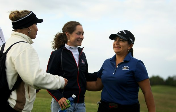 Lizette Salas is hugged by friends after she birdied all three playoff holes to take the last spot for LPGA membership during the final round of LPGA Qualifying Tournament at LPGA International.