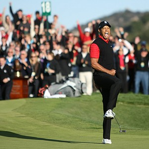 Tiger Woods celebrates after his birdie putt on the 18th hole to win the Chevron World Challenge.